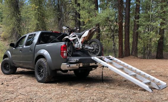 Electric dirt bike shipping with truck and step ramp